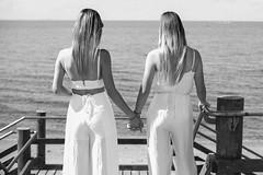 My daughters (Stelex) Tags: ocean girls blackandwhite back view perspective longhair handinhand