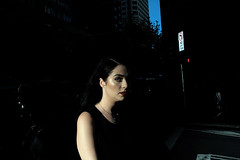 . (ferriswhiskey) Tags: city light shadow woman color colour reflection face 35mm dark crossing sydney australian streetphotography australia nsw fujifilm streetphoto colourstreet xpro1 ferriswhiskey