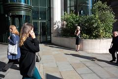 (ziemowit.maj) Tags: london strand streetphotography centrallondon candidphotography ef28mmf18 canon5dmkiii businesswomenonphoneswithmanstaringinthebackground