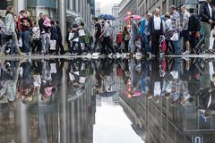 Island of silence (explored) (.niraw) Tags: kln fusgngerzone strasenfotografie pftze spiegelung menschen niraw regenschirm zeppelinstrase wasser ruhe insel