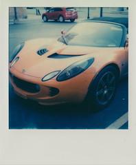 Lotus Elise (DavidVonk) Tags: orange film sports car analog vintage polaroid lotus elise engine headlights instant hood slr680 mid s2 roadster convertable series2