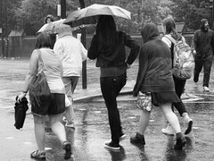 Hurrying in the Rain (cycle.nut66) Tags: road street people blackandwhite castle wet water monochrome rain umbrella four drops crossing cardiff olympus micro grayscale thirds evolt epl1 mzuiko