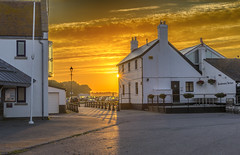 Sundowners (nicklucas2) Tags: christchurch sun yellow sunrise seaside pub quay flare mudeford