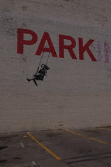 Iconic Girl on a swing by Banksy, circa 4/2010 (Joey Z1) Tags: losangeles banksy sola urbanscene broadwayst broadwayla curbedla streetartla asseeninlaweekly urbanscenela laasseenbyjoeyz1 girlonaswingbybanksy banksysgirlonaswing parkbybanksyinla urbanartbybanksy