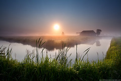 misty sunrise over river in farmland (Olha Rohulya) Tags: morning blue sunset summer sky sun sunlight house mist holland building green home nature water netherlands dutch grass sunshine silhouette misty fog farmhouse rural sunrise river season landscape outside outdoors countryside early canal scenery silent shine view sundown horizon seasonal scenic meadow tranquility nobody nopeople surface calm farmland clear silence groningen tranquil