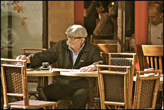early morning on rue des abbesses .... (ana_lee_smith) Tags: street man paris france macro male vintage lens photography cafe candid sigma montmartre sidewalk beercan tones f4 brasserie bisto ruedesabbesses analeesmith minoltaaf70210mm sonyslta33