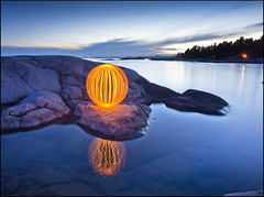 Auburn Narcissus (Rodrick Dale) Tags: orange lake ontario canada lightpainting water rock reflections evening bay orb georgian narcissus