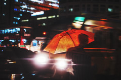 Metropolis Downpour (Shutterfreak ) Tags: street city motion blur cars silhouette night umbrella 35mm buildings droplets bokeh pedestrian headlights busstop busy rush dhaka busses rainfall hasin inkiad