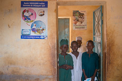 Pupils of Malikawa Garu Islamic Primary School, Bichi, Kano standing by the poster promoting the benefits of handwashing with soap in their school