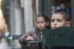 learning to whistle (idni . idniama) Tags: street boy green girl nikon girona gettyimages 2013 learningtowhistle idni gettyimagesiberiaq3