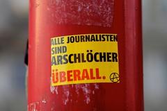 Wien (austrianpsycho) Tags: vienna wien sticker mast stange journalisten spruch a mariahilferstrase christianbrodaplatz uberall arschlocher allejournalistensindarschlocher