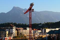 Salzburg Hauptbahnhof (austrianpsycho) Tags: houses mountain salzburg berg crane bahnhof berge hauptbahnhof dach hbf kran cityshuttle baukran salzburghbf hauser gebaude salzburghauptbahnhof