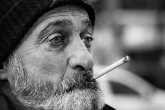 With a cigarette upward (Giulio Magnifico) Tags: hat beard cigarette character smoker upward udine nikond800e nikkormicro105mmafsvrf28