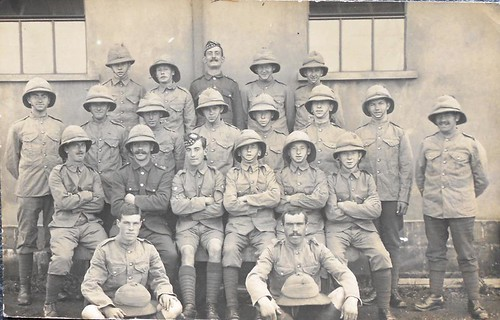 A  photo postcard of men of the 1-7th Royal Scots kitted out for Gallipoli. The back of the card reads this is our own hut.