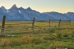 Forgotten Fence (kevin-palmer) Tags: wood autumn sunset sky snow mountains green fall field grass fence evening wooden nationalpark sunny september snowcapped clear forgotten glaciers wyoming peaks grandteton hdr grandtetonnationalpark mormonrow antelopeflats tamron1750mmf28 moultonhomestead pentaxk5