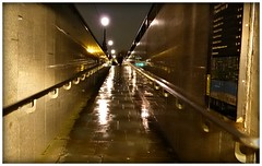embankment walkway (charleyk) Tags: wet reflections evening flags handrail