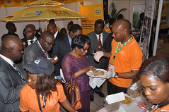 Participants taste IITA crop recipes produced from maize, cassava and banana (IITA Image Library) Tags: food banana exhibition recipes maize cassava economicsummit manihotesculenta
