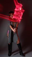 Ragnark XV: Swordplay (wirehead) Tags: longexposure light red woman lightpainting girl painting model long exposure sword ep3 14150mm strobist roselleangel
