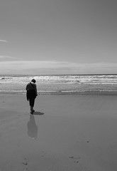 Staring at the Sea (Murkydepths) Tags: sea sky white seascape black beach water monochrome relax four person grey sand surf gray mother wave panasonic devon single simple staring contemplative woolacombe thirds morthoe