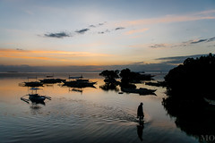 Island sunset (mathieuo1) Tags: ocean travel sunset shadow summer sky reflection nature water boats island dawn landscapes fisherman nikon asia philippines dream vert bohol panglao discover
