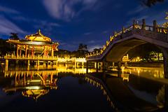 | Tainan park (Raider Chen ) Tags: park bridge blue light sunset sky lake reflection water taiwan tainan