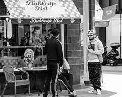 Vanilla Ice (Dutch_Chewbacca) Tags: life street camera city people urban bw white black color ice netherlands monochrome dutch canon photography eos spring outdoor no candid centre nederland citylife sigma sunny streetlife human vanilla unposed 013 tilburg brabant stad noordbrabant ijs behaviour straatfotografie unpolished