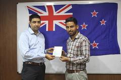 Mr. Gurvinder Singh Kang ( Director of West Highlander Chandigarh) handing over New Zealand dependent visa to a client