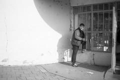 Minolta Hi-Matic G - Man at the Post Office (Kojotisko) Tags: bw streetphotography brno creativecommons czechrepublic streetphoto vx400 konicamonochromevx400 minoltahimaticg konicamonochrome