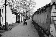 Hutong Street (gwpics) Tags: china street blackandwhite bw building history film monochrome architecture mono blackwhite tricycle transport chinese beijing streetphotography lifestyle historic transportation 1998 hutong deprived society slum socialdocumentary slums socialcomment streetpics strasenfotograpfie