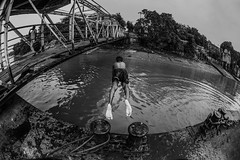 Flying boy. (souravpaul2) Tags: street travel boy blackandwhite india canon river jump activity kolkata
