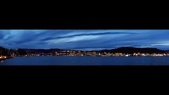 good evening wellington #2 (mugley) Tags: urbanlandscape night panorama longexposure travel skyline cityscape buildings architecture towers skyscrapers cranes water lambtonharbour lights hills clouds cloudage blue city urban orientalparade orientalbay suburbs wellington northisland newzealand nz olympus omd em5 micro43 microfourthirds digital mirrorless olympusem5 1442 kitlens zoom mzuiko1442mmf3556iir stoppeddown zoomedin 28mm f71 iso200 15s 7xp stitched