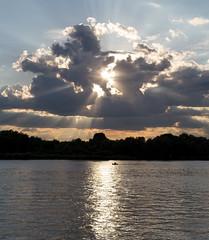Sunshine (Indigo_Flow) Tags: sunshine river water sun sky clouds reflection siberia boat
