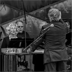 Lip sync (John Riper) Tags: street bw white black netherlands monochrome choir canon john square photography mono zwartwit candid den ad lips l lip sync maestro ijssel conductor aan 6d 24105 capelle straatfotografie riper johnriper