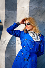 Portrait of aYoung  Woman in a Blue Coat (George Oze) Tags: barcelona woman sexy sunglasses vertical closeup spain model relaxing trenchcoat blonde attractive metropolitan sophisticated beautifulpeople burberry classy fashionmodel handinhair caucasianethnicity modelreleased springfashion burberrycoat 12length 3035yearsold lokkingout