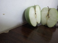 IMG_20130609_003521 (Ahmed AlHallak) Tags: 2 green apple stem with seeds half connected sliced stalk تفاح أخضر قرن بذور مقسوم بالنصف