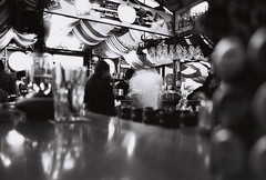 Bar seat (Kevin Orbitz) Tags: bw white black film analog 35mm nikon 100 f70 ilfordpan