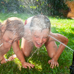 Children playing in a summer garden (Dmitri Naumov) Tags: boy summer two people playing nature wet water girl face grass childhood smiling youth yard garden children fun outdoors shower happy kid backyard child play emotion little joy lawn meadow lifestyle happiness drop spray together sprinkler droplet positive activity splash cheerful irrigation spraying watering actions caucasian sprayer sprinkling twochildren
