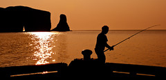 Fishing at Perc Rock (Ronald Santerre) Tags: canada sunrise fishing fisherman quebec qubec northamerica gaspsie travelphotography quebectrip naturalarch rocherperc percrock tourismequbec quebectourism vacancesqubec voyagesqubec quebectravel ronaldsanterre gettyimagescanada