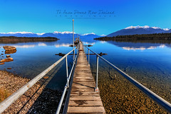Te Anau Downs New Zealand (AzmanMd) Tags: wood travel bridge blue sunset newzealand summer wallpaper vacation sky sun lake color water weather stone port sunrise canon landscape evening town spring colorful peace slow view natural jetty peaceful bluesky tourist teanau longexposer canon40d