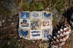 with pine cone and moss (Woods Whisperer, Ram Krishan Kaur) Tags: trees tree bird art fall thread leaves pine forest studio photography berry woods vermont quilt heart stitch nest embroidery sewing textile evergreen pineneedles bark embellishment stitching crow ferns fiberart patchwork fiber crows quartz gratitude stitched embroidered embellished handstitched ravens tapestry pinecones embellish textileart artquilt putneyvermont fiberartist tafa artcloth valdani valdanithread westminstervermont vision:outdoor=0795
