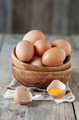 Eggs (Oxana Denezhkina) Tags: wood food brown chicken cooking broken yellow closeup breakfast easter cuisine wooden healthy raw natural market farm background egg group shell nobody fresh eat poultry eggs organic diet chalkboard boiled fragile protein yolk eggshell ingredient uncooked albumen