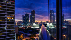 colores (almostsummersky) Tags: city longexposure blue sunset urban orange skyline night clouds buildings lights hotel skyscrapers florida miami dusk balcony horizon railing