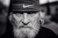 The killer's eyes (Giulio Magnifico) Tags: life lighting boss white man look closeup beard expression character homeless citylife streetphotography streetportrait fair killer bonnet gaze glance clochard udine nikond800e