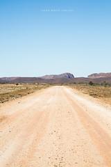 Outback (john white photos) Tags: road red desert flat 4x4 australian dry australia bluesky dirt trail outback remote straight southaustralia plain arid gravel flindersranges fourwheeldrive