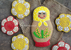 Edible homemade gingerbread as a traditional Russian nesting dolls - matryoshka, on the wooden table (Fiery-Phoenix) Tags: wood red orange woman brown white holiday flower art face cookies yellow cake female bread dessert toy spring yummy eyes doll dolls candy symbol sweet russia traditional treats gingerbread sugar souvenir eat homemade ornament gift present icing tradition nibble foreign mimosa russian edible trade bun babushka confectionery nesting matryoshka matreshka march8