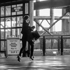 SLIP 2 (John St John Photography) Tags: blackandwhite bw woman blackwhite streetphotography running late wallstreet worldfinancialcenter candidphotography nywaterway pier11 hobokenferryterminal hobokenterminal hobokennjtransitterminal