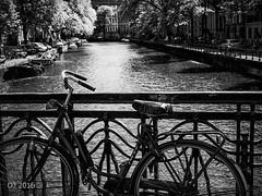 Amsterdam bicycle (einervonneruhr) Tags: bw white black holland netherlands amsterdam bicycle olympus sw kanal monochrom fahrrad omd fiets niederlande gracht monchrome 1250mm em5 mzuiko
