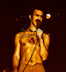 Michael Conen - [PROOF] Frank Zappa closeup with mic [Frank Zappa - Louisville Gardens, Louisville KY 11-10-77] (michael conen) Tags: kentucky louisville canonae1 1977 allrightsreserved frankzappa louisvillegardens michaelconen copyright2013