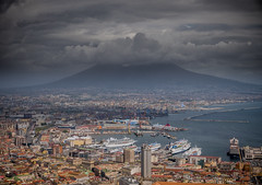 Napoli Centro Storico (elzauer) Tags: city travel sea sky italy mountain history water horizontal architecture outdoors photography volcano harbor europe day cityscape campania purple angle image citylife overcast nopeople it napoli viewpoint oldtown scenics urbanskyline humaninterest tranquilscene mtvesuvius naplesitaly traveldestinations volcaniclandscape buildingexterior gulfofnaples highangleview commercialdock italianculture horizonoverwater builtstructure bayofwater