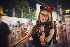 Kitten Chords (tylerkingphotography) Tags: city travel people motion girl lady night thailand photography eyes nikon southeastasia photographer market outdoor explore backpacking violin thai chiangmai 1855mm traveling performer amateur d3100